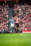 BILBAO, SPAIN - OCTOBER 16: Oscar de Marcos and Mikel Oyarzabal, jump to the ball in the Spanish League match between Athletic Bil Stock Image