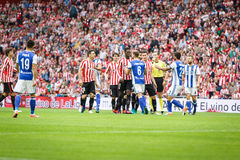BILBAO, SPAIN - OCTOBER 16: Players from both teams argue for a strong foul during the match between Athletic Bilbao and Real Soci Stock Images
