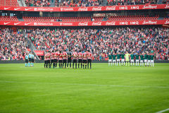 BILBAO, SPAIN - OCTOBER 30: Players from both teams in a minute of silence before the match between Athletic Bilbao and Osasuna, c Royalty Free Stock Photo