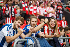 BILBAO, SPAIN - OCTOBER 16: Real Sociedad Fans between Athletic fans in the match between Athletic Bilbao and Real Sociedad, celeb Stock Photo