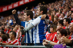 BILBAO, SPAIN - OCTOBER 16: Real Sociedad Fans between Athletic fans in the match between Athletic Bilbao and Real Sociedad, celeb Stock Image
