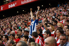 BILBAO, SPAIN - OCTOBER 16: Real Sociedad Fans between Athletic fans in the match between Athletic Bilbao and Real Sociedad, celeb Royalty Free Stock Images