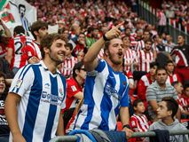 BILBAO, SPAIN - OCTOBER 16: Real Sociedad Fans between Athletic fans in the match between Athletic Bilbao and Real Sociedad, celeb Stock Images