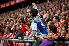 BILBAO, SPAIN - OCTOBER 16: Real Sociedad Fans between Athletic fans in the match between Athletic Bilbao and Real Sociedad, celeb Stock Photography