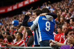 BILBAO, SPAIN - OCTOBER 16: Real Sociedad Fans between Athletic fans in the match between Athletic Bilbao and Real Sociedad, celeb Stock Photos