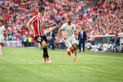 BILBAO, SPAIN - SEPTEMBER 18: Aritz Aduriz and Martin Montoya, in the match between Athletic Bilbao and Valencia CF, celebrated on Royalty Free Stock Photo