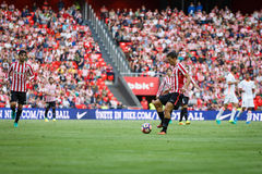 BILBAO, SPAIN - SEPTEMBER 18: Eneko Boveda and Oscar de Marcos, Bilbao players, during the match between Athletic Bilbao and Valen Royalty Free Stock Image