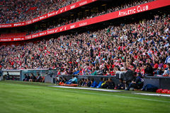 BILBAO, SPAIN - SEPTEMBER 18: The spectators stand and applauding in the stands of the stadium, in the match between Athletic Bilb Royalty Free Stock Photo