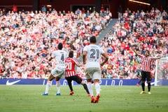 BILBAO SPANIEN - SEPTEMBER 18: Aderlan Santos och Aritz Aduriz, i matchen mellan idrotts- Bilbao och Valencia CF, firade på Fotografering för Bildbyråer