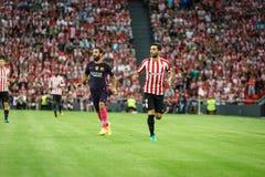 BILBAO, SPANJE - AUGUSTUS 28: Eneko Boveda en Arda Turan in de gelijke tussen Atletische die Bilbao en FC Barcelona, op Augustus  Stock Afbeelding