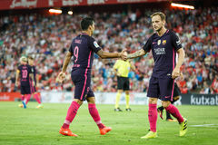 BILBAO, SPANJE - AUGUSTUS 28: Luis Suarez en Ivan Rakitic, FC-spelers, tijdens een Spaanse Ligagelijke tussen Atletische Bilbao e stock foto's