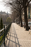 Bilbao street with trees, benches and railings, on a sunny day Stock Images