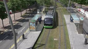Bilbao tram arrives at stop stock video
