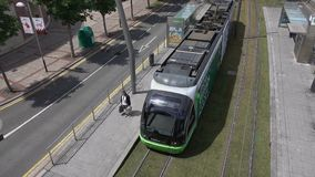 Bilbao Tram pulls away from stop stock footage