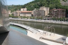 Bilbao, view of the spider sculpture `Maman` by artist Bourgeois. View of the spider sculpture `Maman` by artist Louise Bourgeois, located on Nerviòn river Stock Images