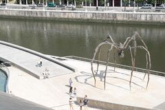 Bilbao, view of the spider sculpture `Maman` by artist Bourgeois. View of the spider sculpture `Maman` by artist Louise Bourgeois, located on Nerviòn river Stock Image