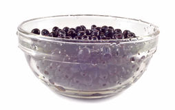 Bilberries in glass bowl. Isolated on white Stock Image