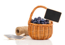 Bilberry in a basket to the board for text Royalty Free Stock Image