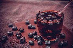 Bilberry drink with the berries and ice cubes. Na refreshing drink with ice and blueberry Stock Photo