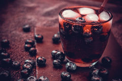 Bilberry drink with the berries and ice cubes. Na refreshing drink with ice and blueberry Stock Images