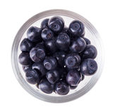 Bilberry fruit in transparent glass Royalty Free Stock Photos