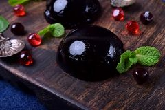 Bilberry hemisphere jelly. On a wooden board royalty free stock photos