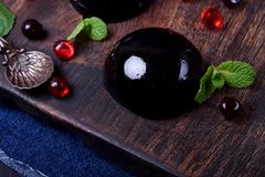 Bilberry hemisphere jelly. On a wooden board royalty free stock image