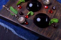 Bilberry hemisphere jelly. On a wooden board stock photo