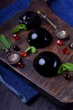 Bilberry hemisphere jelly. On a wooden board stock images