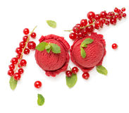 Bilberry ice cream with red currant, top view. Above view of scoops of red currant ice cream fresh berries decorated with leaves of mint on white background Royalty Free Stock Images