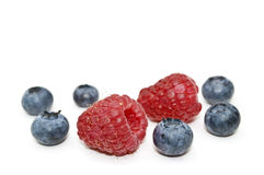 Bilberry and raspberry. Royalty Free Stock Photo