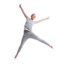 Bild av den glade slanka flickan som poserar i hopp Royaltyfria Bilder
