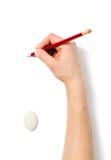 Bild av den mänskliga handen med blyertspennan och radergummit Royaltyfri Fotografi