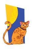 Bild av den orange katten på fönstret Arkivbilder
