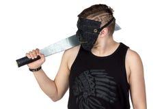 Bild av den unga mannen i maskering med handyxan Arkivbild