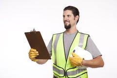 Bild av en byggnadsarbetare med en skrivplatta och en hardhat Arkivfoton