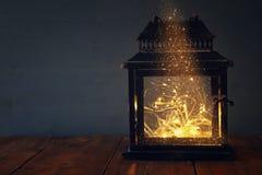 bild av felika ljus inom den gamla lyktan Fotografering för Bildbyråer