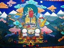 Bild av Padmasambhava aka Guru Rinpoche på väggen av den Taktsang Lhakhang kloster, Paro, Bhutan Royaltyfri Foto