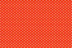 Bild av rött tyg med vita prickar Fotografering för Bildbyråer