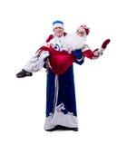 Bild av unga humorister i juldräkter Royaltyfri Fotografi