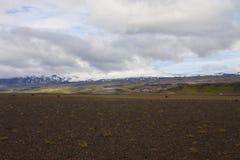 Bild av vattenfallet och liten vik, Island arkivbilder