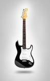 Bild der elektrischen Gitarre über grauem Hintergrund Stockbilder