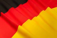 Bild der seidigen gefalteten deutschen Flagge Lizenzfreies Stockbild