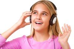 Bild des jugendlichen reizenden Mädchens mit hörender Musik der Kopfhörer Lizenzfreies Stockfoto