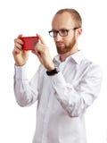 Bild des Mannes Fotos mit seinem Smartphone machend lokalisiert Lizenzfreie Stockbilder