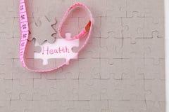Bild des Puzzlespielstückes mit Gesundheit und rotem Machthaber Lizenzfreies Stockfoto