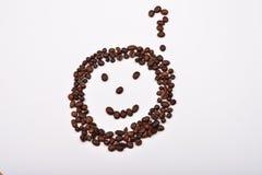 Bild des smileygesichtes mit dem Fragezeichen gemacht von den Kaffeebohnen Lizenzfreie Stockfotos