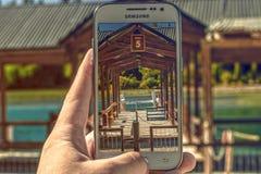 Bild durch ein Mobiltelefon Stockfotos