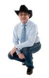 Bild eines älteren Cowboys, der halb gesetzt aufwirft lizenzfreies stockbild