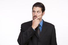 Bild eines durchdachten jungen Geschäftsmannes, der weg schaut Stockbild